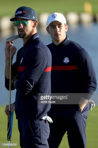 Michael Phelps of Team USA and Nick Jonas of Team USA look on during the celebrity challenge match ahead of the 2018 Ryder Cup at Le Golf National on...