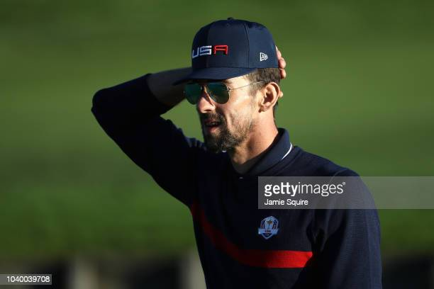 Michael Phelps of Team USA looks on during the celebrity challenge match ahead of the 2018 Ryder Cup at Le Golf National on September 25 2018 in...