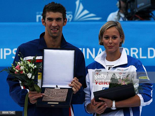 Michael Phelps of the United States and Federica Pellegrini of Italy receive an award after the 13th FINA World Championships at the Stadio del Nuoto...