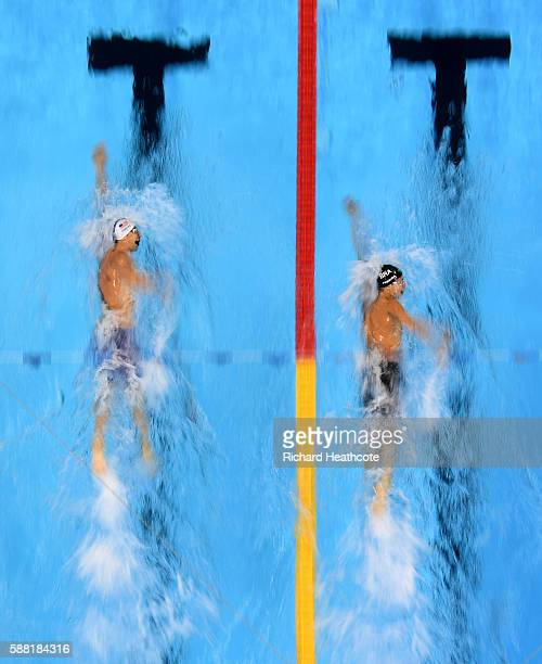 Michael Phelps of the United States and Thiago Pereira of Brazil compete in the Men's 200m Individual Medley heat on Day 5 of the Rio 2016 Olympic...
