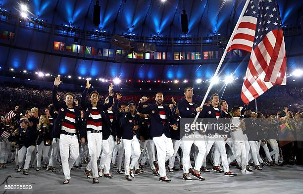 Michael Phelps of the United States carries the flag during the Opening Ceremony of the Rio 2016 Olympic Games at Maracana Stadium on August 5 2016...