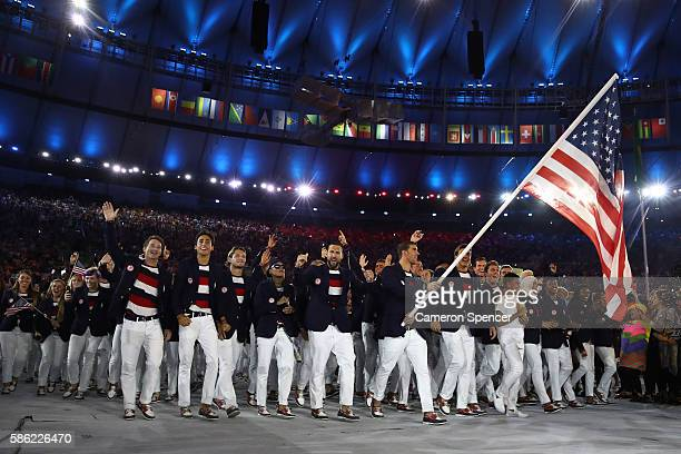 Michael Phelps of the United States carries the flag during the Opening Ceremony of the Rio 2016 Olympic Games at Maracana Stadium on August 5, 2016...