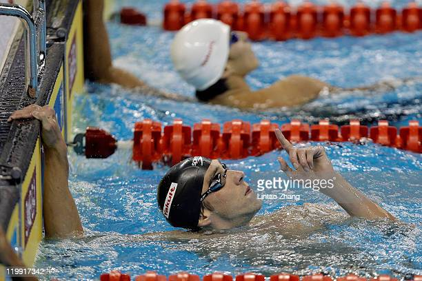 Michael Phelps of the United States celebrates after winning the gold medal in the Men's 200m Butterfly Final during Day Twelve of the 14th FINA...