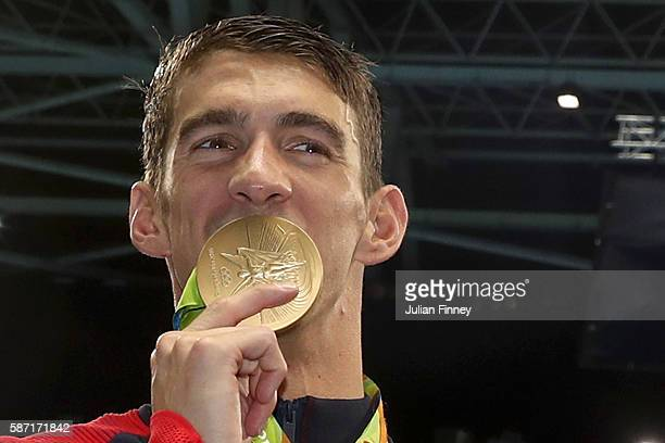Michael Phelps of the United States celebrates after winning the gold medal in the Men's 4 x 100m Freestyle Relay on Day 2 of the Rio 2016 Olympic...