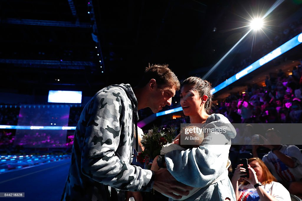 Michael Phelps (L) of the United States celebrates with his fiance Nicole Johnson (R) and their son Boomer (C) after finishing first in the final heat for the Men's 200 Meter Individual Medley during Day Six of the 2016 U.S. Olympic Team Swimming Trials at CenturyLink Center on July 1, 2016 in Omaha, Nebraska.