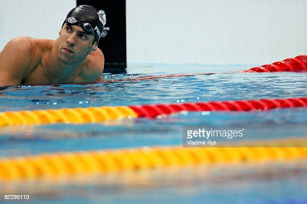 Michael Phelps of the United States competes in the Men's 200m Individual Medley Semifinal 1 held at the National Aquatics Centre during Day 6 of the...