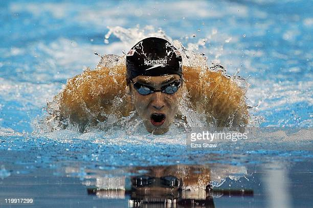 Michael Phelps of the United States competes on the way to winning the gold medal in the Men's 200m Butterfly Final during Day Twelve of the 14th...