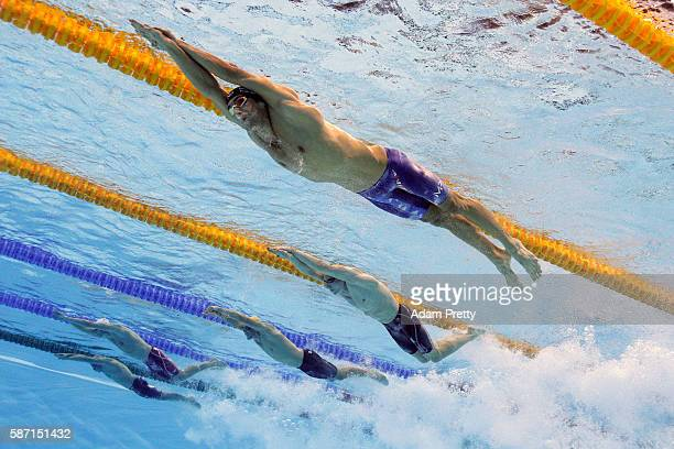 Michael Phelps of the United States Danila Izotov of Russia Kyle Chalmers of Australia Yuri Kisil of Canada and Jasper Aerents of Belgium compete in...