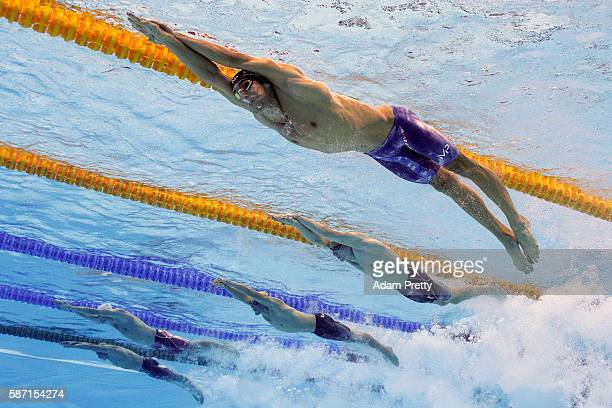 Michael Phelps of the United States Danila Izotov of Russia Kyle Chalmers of Australia Yuri Kisil of Canada and Jasper Aerents of Belgium compete in...