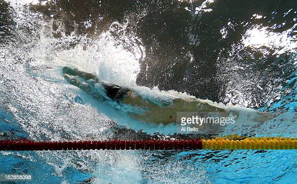 Michael Phelps of the United States dives into the pool in the Men's 100m Meldey Final on Day 8 of the London 2012 Olympic Games at the Aquatics...