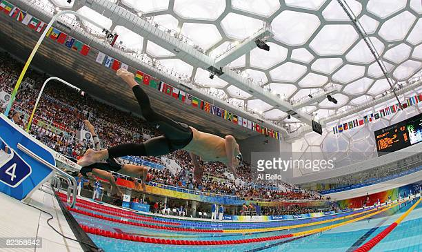 Michael Phelps of the United States dives into the water in the Men's 100m Butterfly Semifinal held at the National Aquatics Centre during Day 7 of...