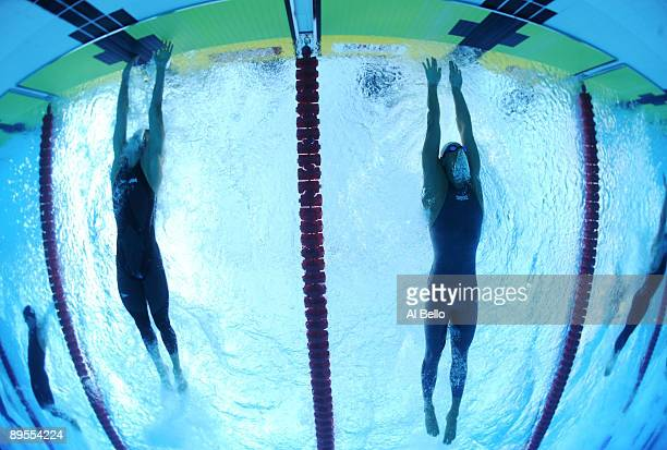 Michael Phelps of the United States finishes just in front of Milorad Cavic of Serbia to win the gold medal and break a new world record in a time of...