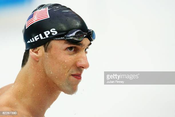 Michael Phelps of the United States finishes the Men's 200m Butterfly Semifinal 2 in first place held at the National Aquatics Center on Day 4 of the...