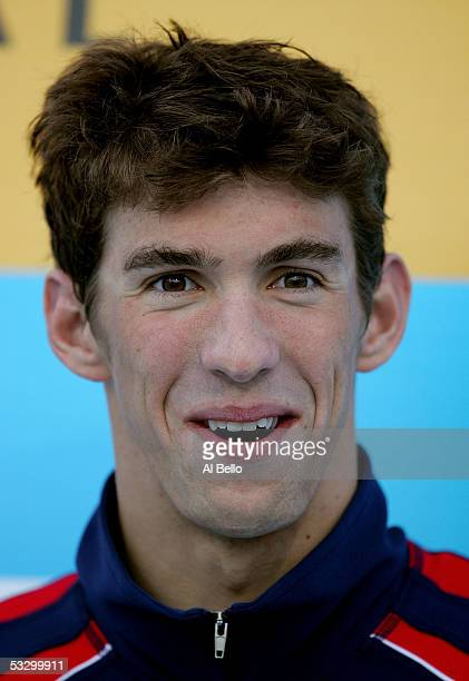 Michael Phelps of the United States laughs on the podium after receiving the gold medal in the 200 meter Individual Medley final during the XI FINA...