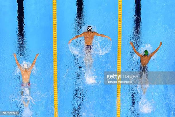 Michael Phelps of the United States leads Chad le Clos of South Africa and Tamas Kenderesi of Hungary in the Men's 200m Butterfly Final on Day 4 of...