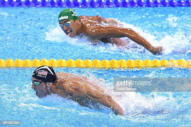 Michael Phelps of the United States leads Chad le Clos of South Africa in the Men's 200m Butterfly Final on Day 4 of the Rio 2016 Olympic Games at...