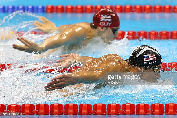 Michael Phelps of the United States leads James Guy of Great Britain in the Men's 4 x 100m Medley Relay Final on Day 8 of the Rio 2016 Olympic Games...