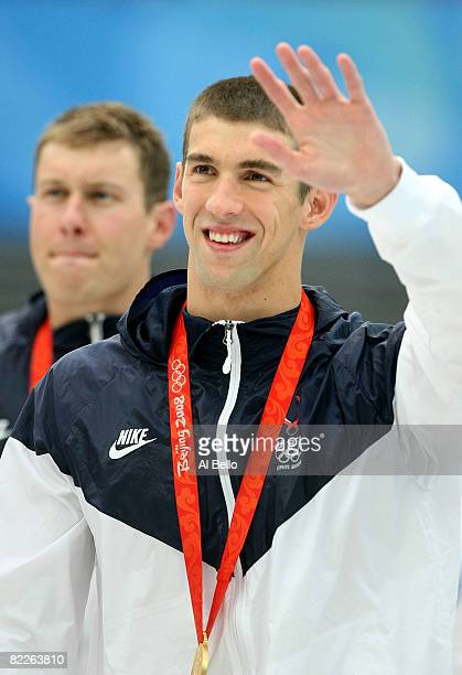 Michael Phelps of the United States poses with the gold medal during the medal ceremony for the Men's 200m Freestyle held at the National Aquatics...