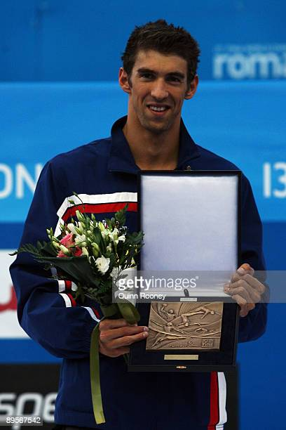 Michael Phelps of the United States receives an award after the 13th FINA World Championships at the Stadio del Nuoto on August 2 2009 in Rome Italy