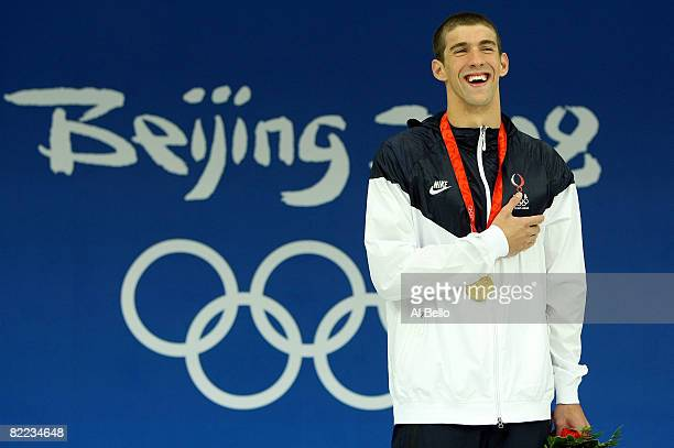 Michael Phelps of the United States receives the gold medal during the medal ceremony for the Men's 400m Individual Medley event held at the National...