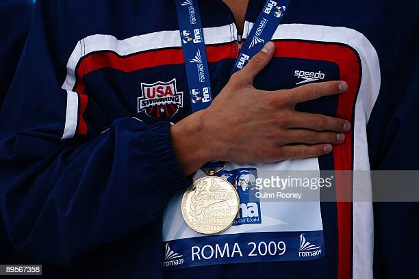Michael Phelps of the United States receives the gold medal during the medal ceremony for the Men's 4x 100m Medley Relay Final during the 13th FINA...