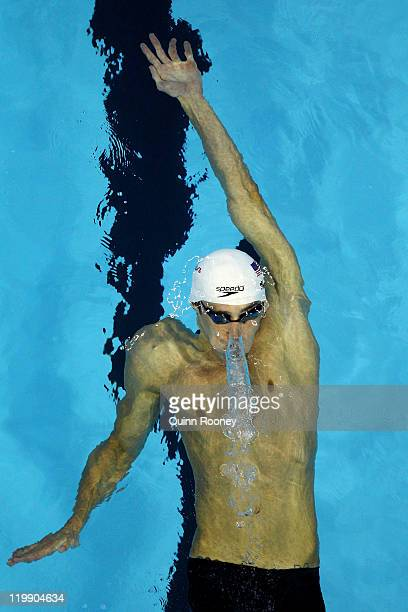 Michael Phelps of the United States swims the backstroke leg in heat five of the Men's 200m Individual Medley heats during Day Twelve of the 14th...