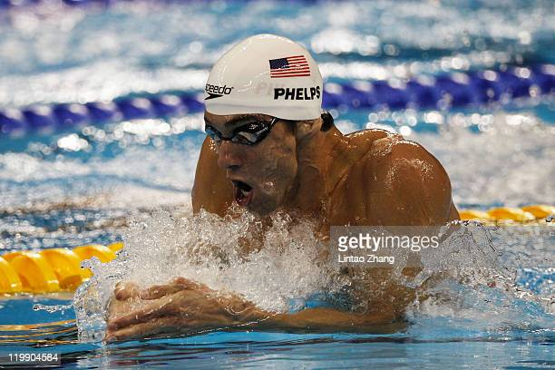 Michael Phelps of the United States swims the breaststroke leg of the Men's 200m Individual Medley in heat five during Day Twelve of the 14th FINA...