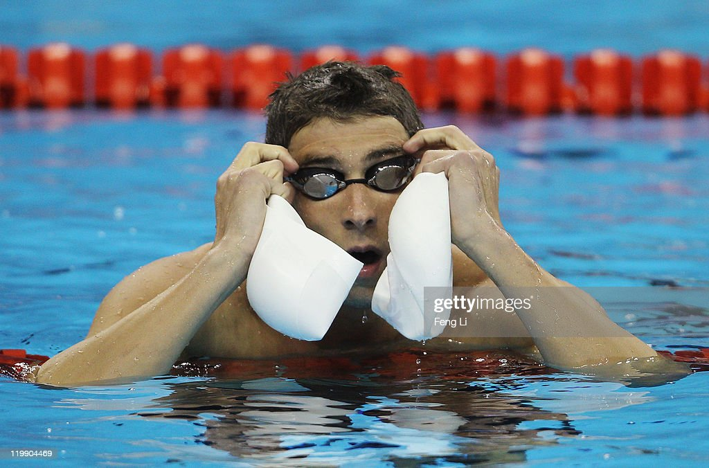 8e36670e118 Michael Phelps of the United States takes off his cao and goggles ...