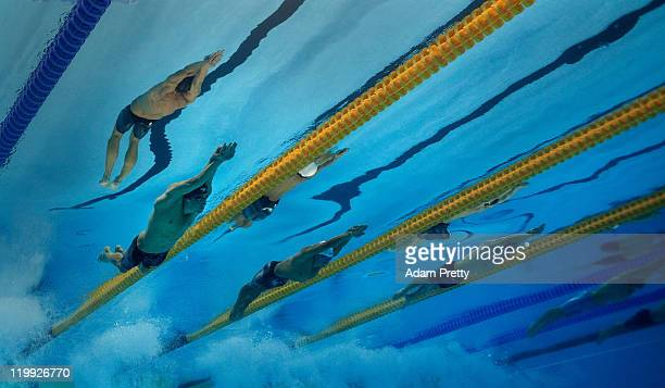 Michael Phelps of the United States Takeshi Matsuda of Japan and Yin Chen of China compete in the Men's 200m Butterfly final during Day Twelve of the...