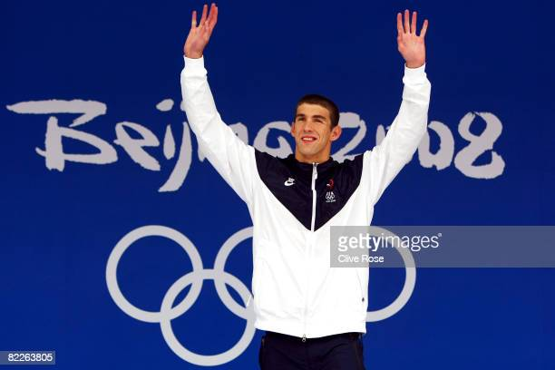 Michael Phelps of the United States waits to receive the gold medal during the medal ceremony for the Men's 200m Freestyle held at the National...