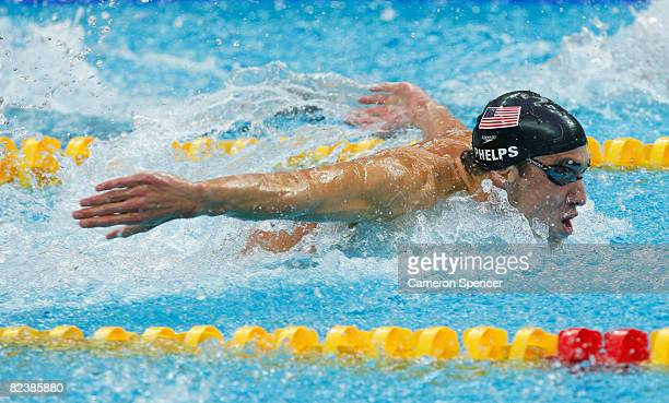 Michael Phelps of the Unites States competes in the butterfly leg of the Men's 4x100 Medley Relay held at the National Aquatics Centre during Day 9...