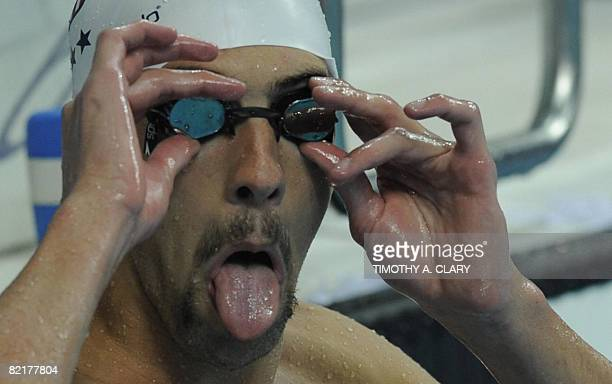 Michael Phelps of the US makes a face during a swim training session at the National Aquatics Center also known as the Water Cube in preperation for...