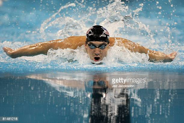 Michael Phelps of the USA swims in the final of the 100m breaststroke during day 2 of the Mutual of Omaha Swimvitational at the Qwest Center June 6...
