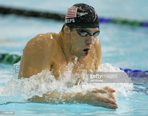 Michael Phelps of the USA swims to a first place finish as he sets a new world record of 1 minute 5584 seconds in the Men's 200m Individual Medley...