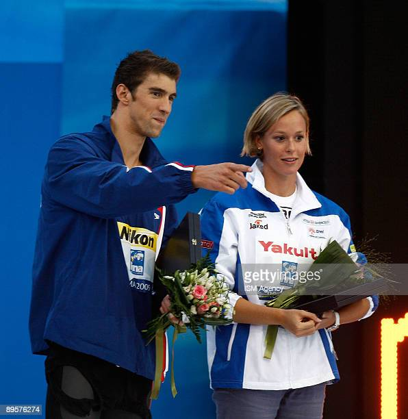Michael Phelps of United States and Federica Pellegrini of Italy receive the Fina Award during the 13th FINA World Championships at the Stadio del...