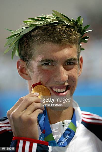 Michael Phelps of USA receives the gold medal for the men's swimming 100 metre butterfly event on August 20 2004 during the Athens 2004 Summer...