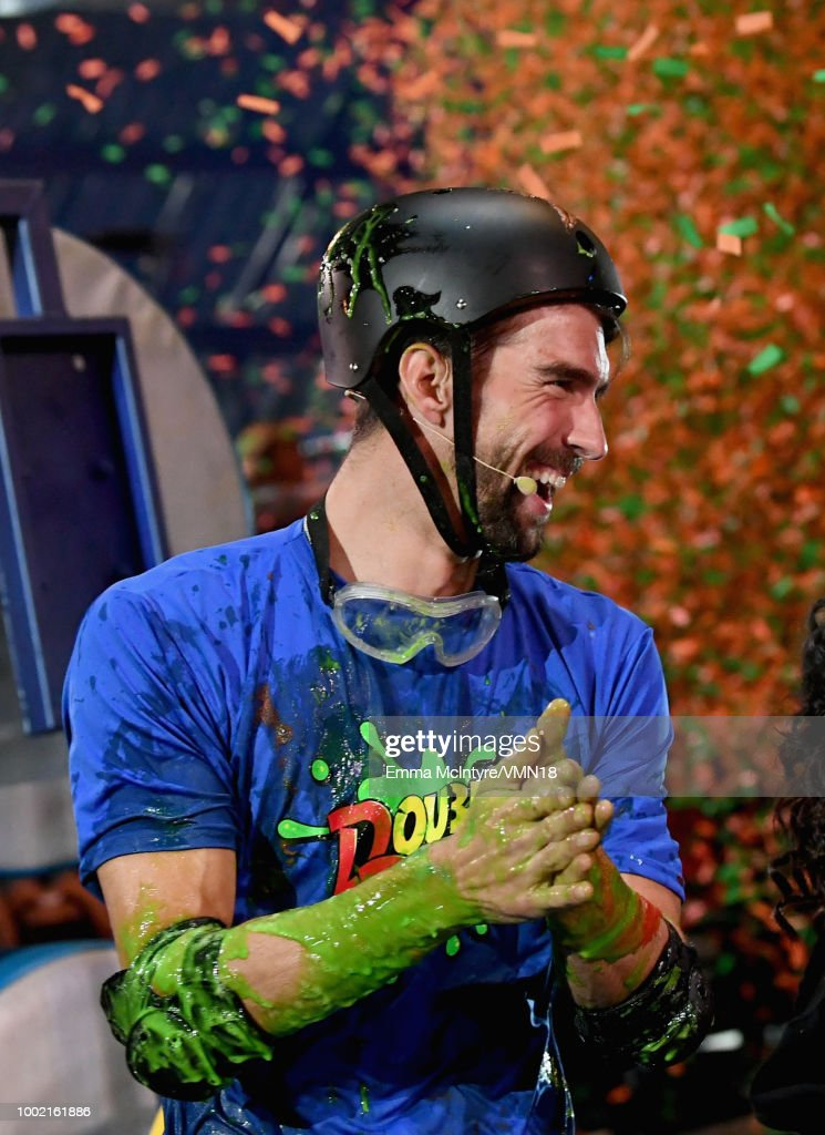 Michael Phelps participates in a challenge during the Nickelodeon Kids' Choice Sports 2018 at Barker Hangar on July 19, 2018 in Santa Monica, California.