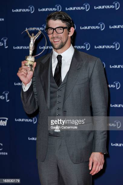 Michael Phelps poses with his award for 'Laureus Academy Exceptional Acheivement Award' attends the Winners Press Conferences Photocall at the...