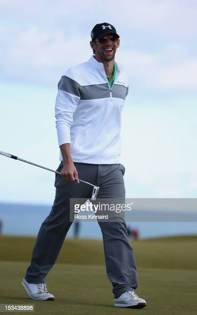 Michael Phelps reacts after putting on the nineth green during the second round of The Alfred Dunhill Links Championship at Kingsbarns Golf Links on...