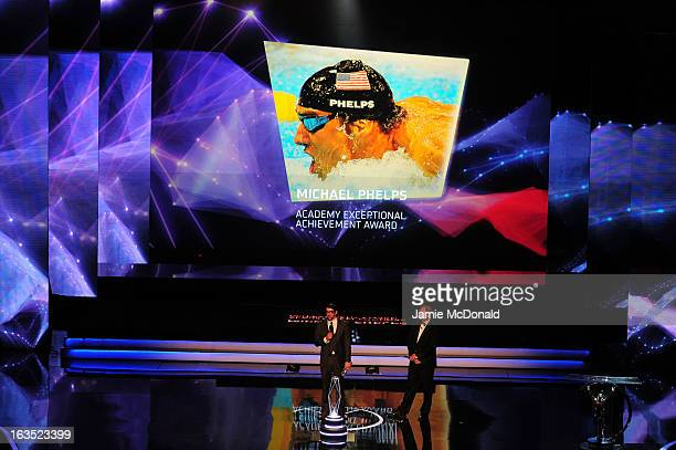 Michael Phelps receives his Laureus Academy Exceptional Acheivement Award from Laureus Academy Member Sir Steve Redgrave during the awards show for...