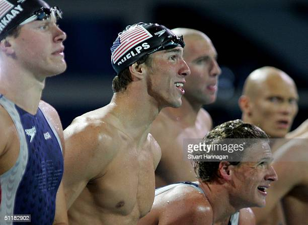 Michael Phelps , Ryan Lochte and Peter Vanderkaay of USA react next to Grant Hackett and Michael Klim of Australia during the men's swimming 4 x 200...