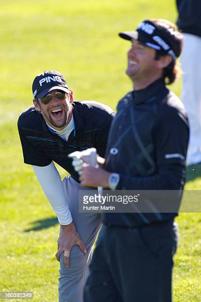 Michael Phelps shares a laugh with Bubba Watson on the 18th green during the Wednesday ProAm of the Waste Management Phoenix Open at TPC Scottsdale...