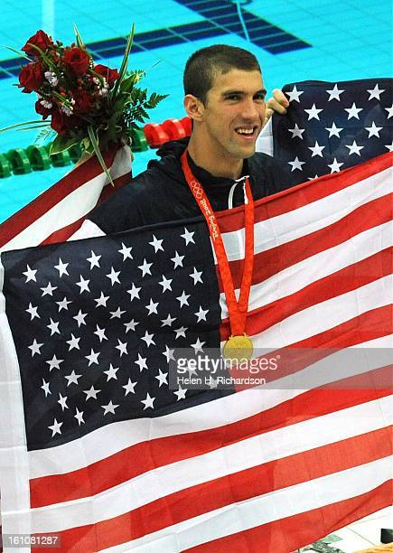 Michael Phelps shows off his gold medal American superstar swimmer Michael Phelps and his team of Aaron Peirsol backstroke Brendan Hansen...