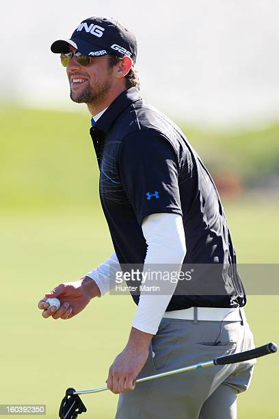 Michael Phelps stands on the 18th green during the Wednesday ProAm of the Waste Management Phoenix Open at TPC Scottsdale on January 30 2013 in...