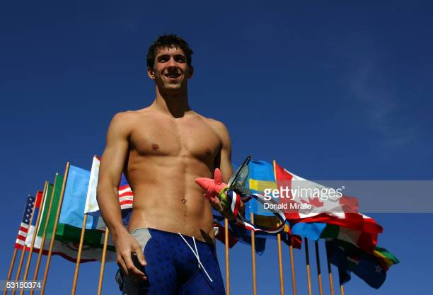 Michael Phelps stands on the Medal Podium after winning the Men's 100M Butterfly Final during the Santa Clara Grand Prix on June 25 2005 at the Santa...