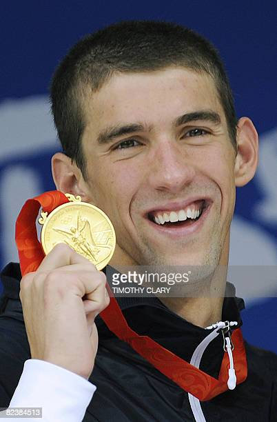 Michael Phelps stands on the podium for the men's 4 x 100m medley relay swimming final medal ceremony at the National Aquatics Center during the 2008...