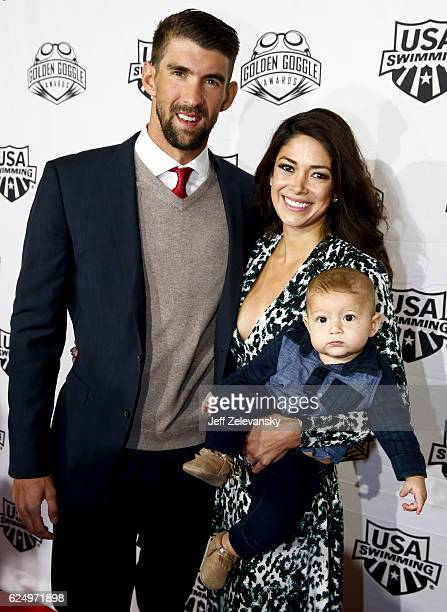 Michael Phelps wife Nicole Johnson and their son Boomer arrive to the 2016 Golden Goggles Awards at the Marriott Marquis Hotel on November 21 2016 in...