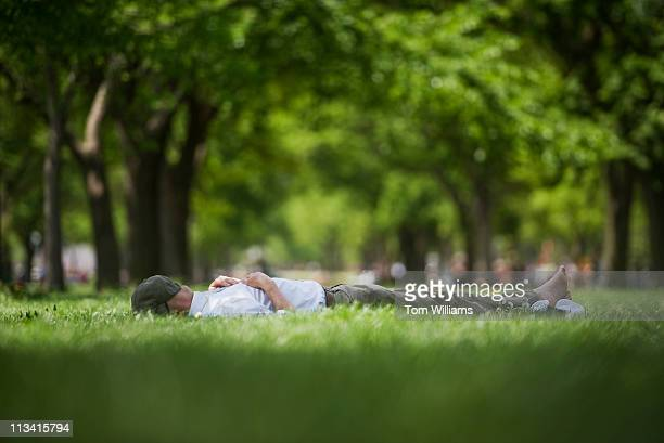 Michael Pierce of the National Gallery of Art, rests on the National Mall on a day were the temperature reached the mid 80s.