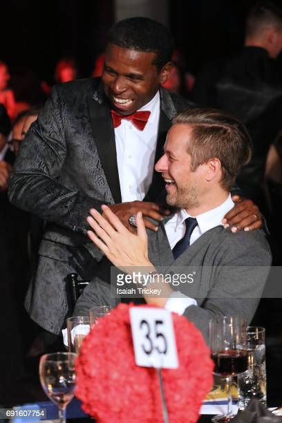 Michael 'Pinball' Clemons CoFounder of the Pinball Clemons Foundation and singer Trevor Guthrie attend the Victory Charity Ball at CBC Toronto on...
