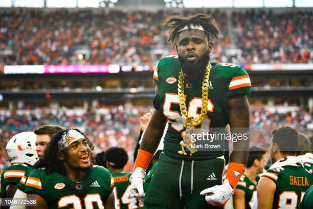 Michael Pinckney of the Miami Hurricanes gets the crowd going with The Turnover Chain in the second half against the Florida State Seminoles at Hard...